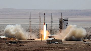 A handout picture released by Iran's Defence Ministry on shows a Simorgh (Phoenix) satellite rocket at its launch site at an undisclosed location in Iran. (AFP)