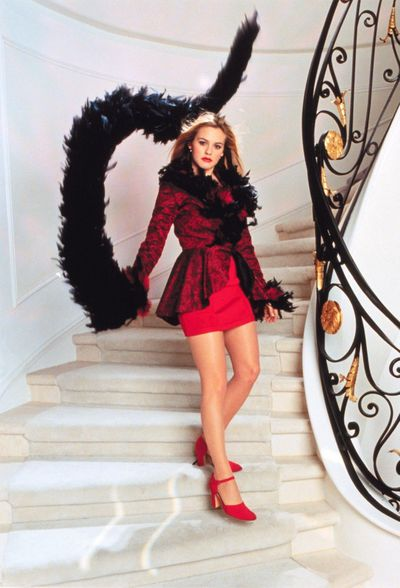 <p>Cher Horowitz in a red Azzedine Alaia dress, feathered jacket and satin pumps.&nbsp;<em>Clueless&nbsp;</em>1995</p>