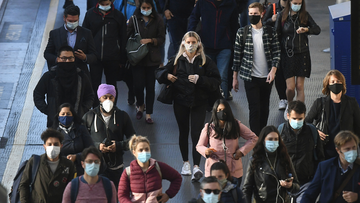 Commuters at Waterloo Station, in London, at 08:54hrs on Thursday, after Prime Minister Boris Johnson announced a range of new restrictions to combat the rise in coronavirus cases in England. Victoria Jones/PA Wire