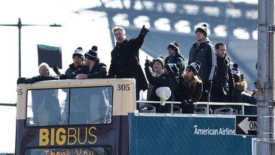 Philadelphia Eagles NFL football team head coach Doug Pederson points to the crowd gathered during the Super Bowl LII victory parade. (AAP)