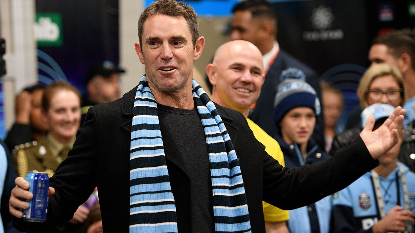 NSW State of Origin coach Brad Fittler presents secret book to players to commemorate win