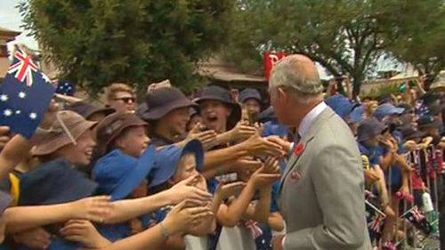 Prince Charles is greeted by a mob of enthusiastic school kids. (Nine News)