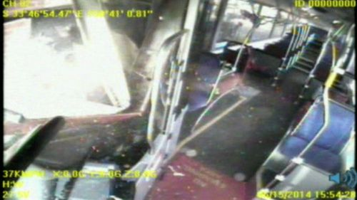 Witnesses reporting hearing a big bang when the bus crashed. No one was injured. (9NEWS)