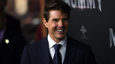 Tom Cruise is all smiles on the black carpet at the State Theatre. (AAP)