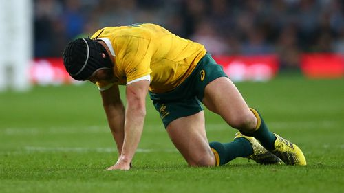 Matt Giteau left the field with a head injury in the first half and did not return. (Getty)