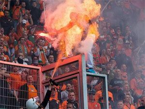 A Polish football fan is engulfed by flames. (supplied)