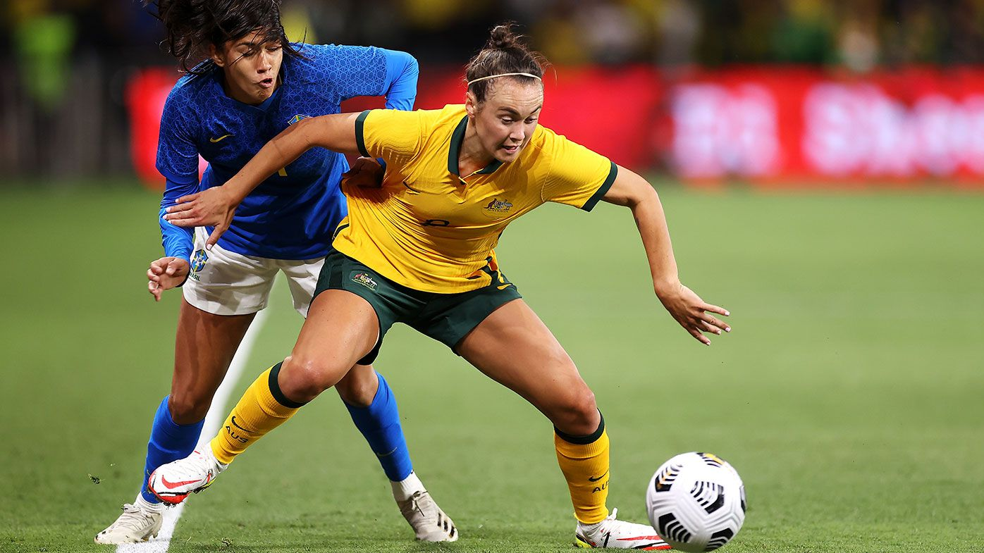 Antônia of Brazil and Caitlin Foord of the Matildas compete for the ball