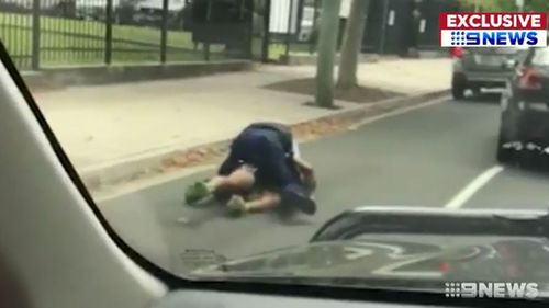 The driver was wrestled to the ground by police.