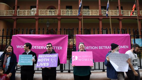 A small group of pro life anti abortion protesters rally outside NSW State Parliament as the Reproductive Health Care Reform Bill 2019 debate continues in the New South Wales.