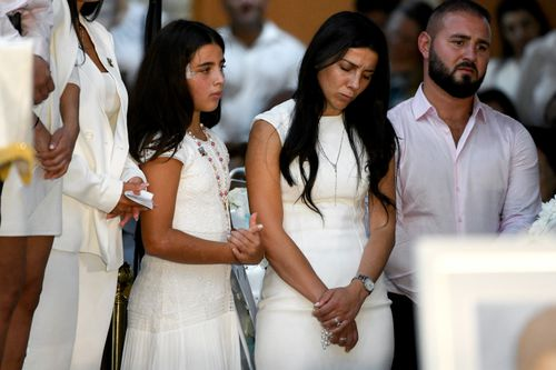 Leila Geagea (middle) and daughter (left) are seen during the funeral for her children Antony Abdallah, 13, Angelina Abdallah, 12, and Sienna Abdallah, 8, at Our Lady of Lebanon Co-Cathedral in Sydney, Monday, February 10, 2020.