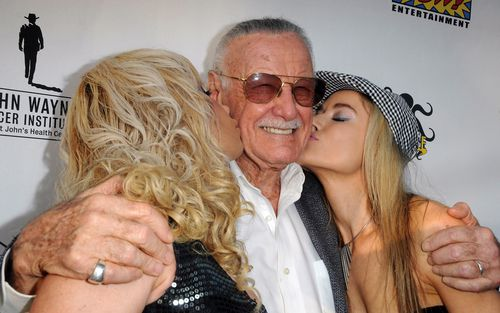 Actresses Diana Terranova and Paula Labaredas plant a kiss on Stan Lee at a charity auction for The John Wayne Cancer Institute in June 2012 in Culver City, California. Picture: WireImage