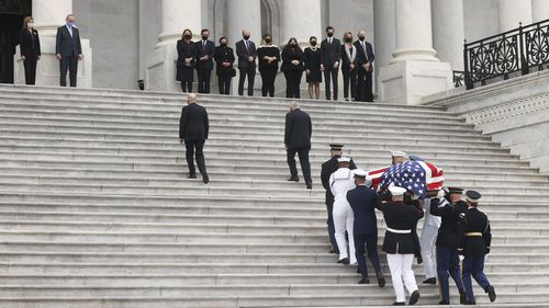The flag-draped casket of Justice Ruth Bader Ginsburg arrives at the US Capitol, where Ginsburg will lie in state Friday, Sept. 25, 2020, in Washington.