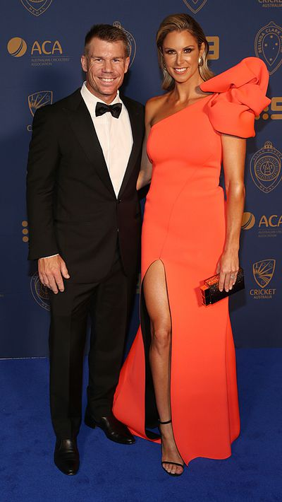 David Warner and his wife Candice Warner brighten up the blue carpet.