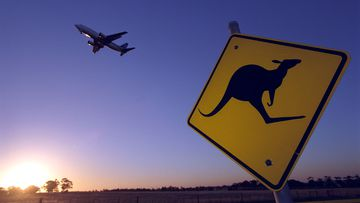 A plane takes off from a rural Australian airport.