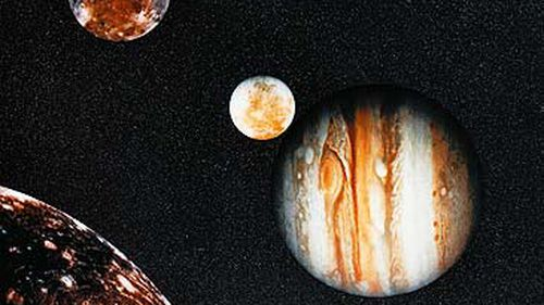 Photograph of Jupiter and its moons from Voyager (Getty)