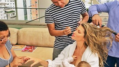 Giselle Bundchen breastfeeds daughter Vivian while preparing for a shoot.