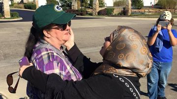 Ms Boutinkhar and Annie share a hug outside the Islamic centre in Columbus, Ohio. (Facebook/Cynthia Cox de Boutinkhar)