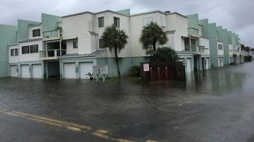 Floodwaters surround a condo in the aftermath of Tropical Storm Nate. (AAP)