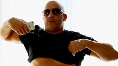 Vin Diesel lifts his shirt to the haters.