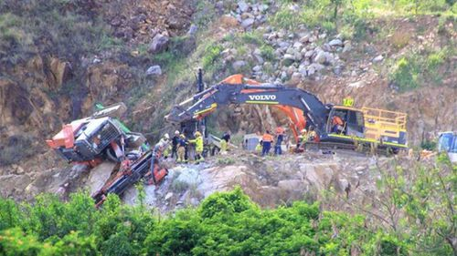 The excavator has come to a rest on a ledge. (Image courtesy of Nadine Granzien).