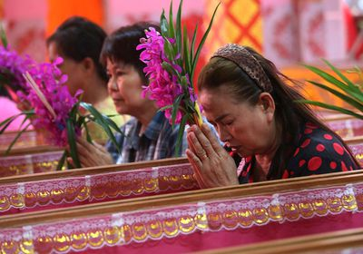 Worshippers pray as they take turns sitting in coffins at the Takien temple in suburban Bangkok, Thailand. Worshippers believe that the coffin ceremony – symbolising death and rebirth – helps them rid themselves of bad luck.