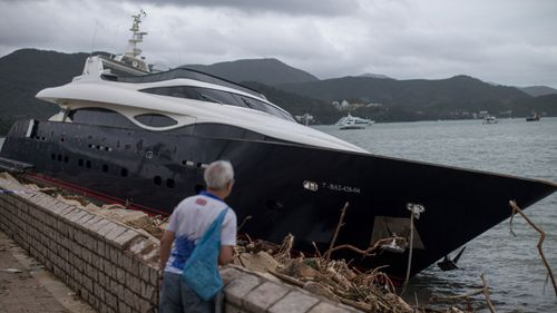 This yacht was washed up on a sea wall in Hong Kong.