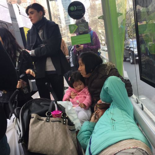 Injured passengers wait for emergency services at the corner of Spencer and Bourke Streets. (Twitter)