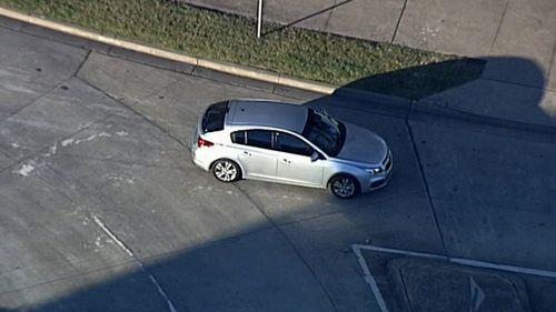A car carrying Matthew De Gruchy leaves Long Bay jail.