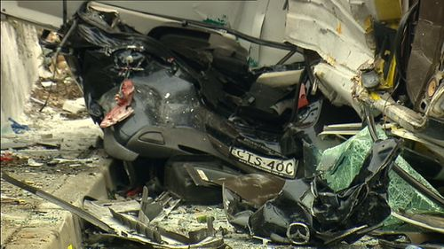 A woman was trapped in the wreckage for almost 90 minutes. (9NEWS)