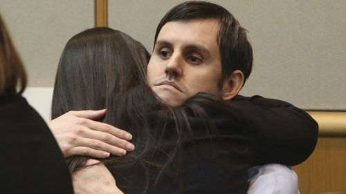 John Jonchuck hugs his attorney Jessica Manuele after a jury found him guilty.