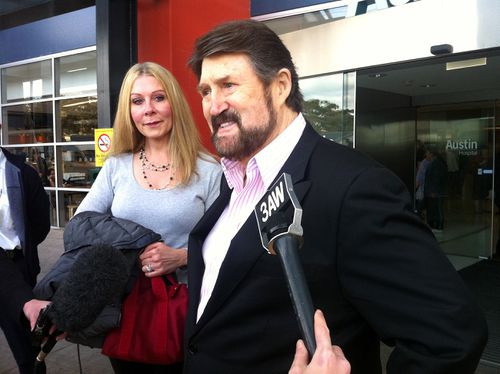 Beaming broadcaster Derryn Hinch with his teary wife Chanel Hayton, leaves Austin Hospital after receiving a liver transplant last week in Melbourne, Saturday, July 16, 2011. (AAP)
