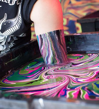 """<p><strong>Body marbling ...</strong></p> <p>This festival trend of kaleidoscope body dipping is easy to do at home too. Pioneered by <a href=""""http://www.blacklightvisuals.com/"""" target=""""_blank"""">Black Light Visuals</a>, they recommend you use  acrylic paints and salty water. </p> <p>1. Fill a tub with salt water (salt helps the paint stick to skin).</p> <p>2. Squeeze in tubes of acrylic paint.</p> <p><strong>3. </strong>Swirl it around with a wooden spoon.</p> <p><strong>4. </strong>Dip your arm or just hands slowly into the water then slide gently out.</p> <p><strong>5. </strong>Give your arm a final dip in paint-free water, then don't touch until the paint on your skin is dry.</p> <p><strong><br /> </strong></p>"""