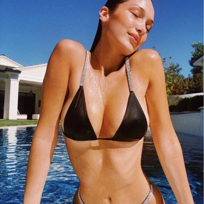 Bella Hadid celebrates perfect pool day in rhinestone bikini<br /> <br />