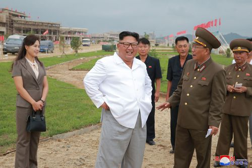 North Korean leader Kim Jong Un, accompanied by his wife Ri Sol Ju, visits a construction site in the Wonsan-Kalma coastal tourist area.