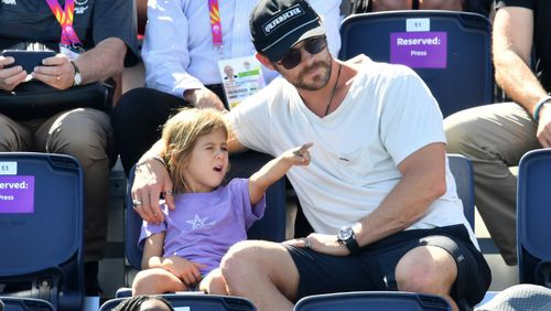 Hemsworth takes in the Commonwealth Games action with daughter India Rose