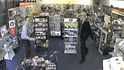 Hodge flailed a knife at the postmaster during his attack on the office. (9NEWS)
