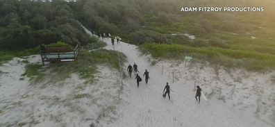 The group fled from the water after the alert was raised.