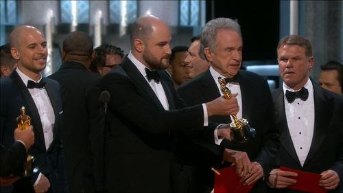 Brian Cullinan (right) reacts as Best Picture is incorrectly awarded. (9NEWS)