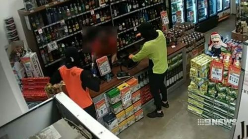 The thieves waved a gun directly at the bottle shop worker.