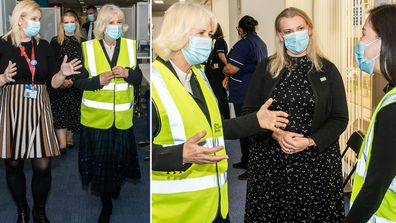 Camilla, Duchess of Cornwall, Royal Voluntary Service President, speaks to Liyann Ooi, a NHS Volunteer Responder Steward at Wembley Vaccination Centre on February 23, 2021 in London, England