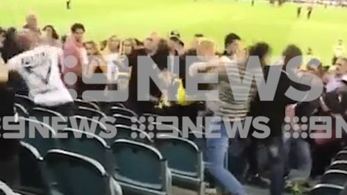 Video has emerged of a violent brawl in the MCG stands after last night's AFL season opener.