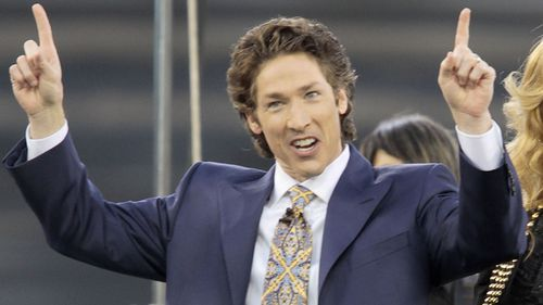 "2010 file photo shows Lakewood Church pastor Joel Osteen at Dodger Stadium during his ""A Night of Hope"" in Los Angeles. (Associated Press)"