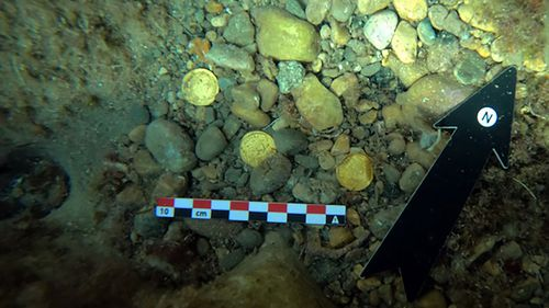 Archaeologists said the coins may have been hidden amid the downfall of the Western Roman Empire.