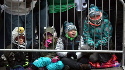 Young Philadelphia Eagles NFL football team fans wait behind a barricade for the start of the Eagles team parade and celebration. (AAP)