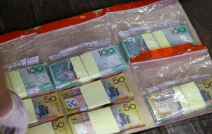 Three charged after police seize $200,000 and drugs in raid on properties
