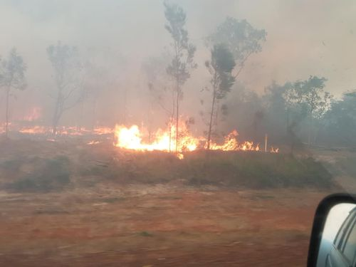 The grass fire at Humpty Doo remains at an 'Advice' alert level, but authorities have urged people to stay away.