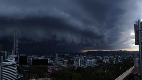 The storm pictured rolling in from the roof of the Hotel Grand Chancellor on Leichhardt Street, Brisbane. (Shane Faulkner)