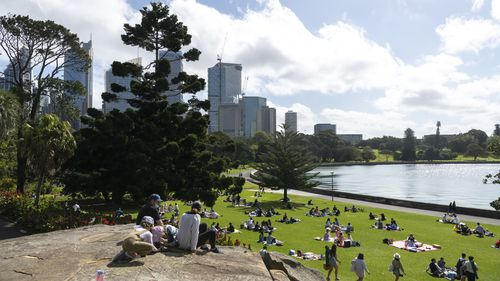People picnic in Sydney's Botanical Gardens.