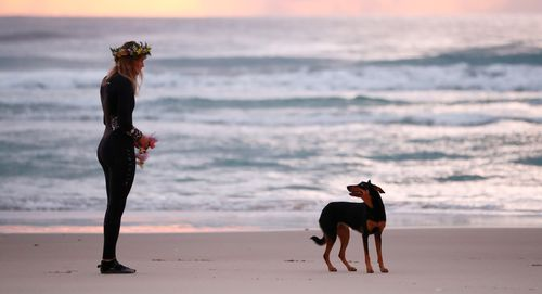 Alex Pullin's girlfriend Ellidy Vlug and kelpie Rummi pay respects in memory of Alex 'Chumpy' Pullin on July 11, 2020 in Gold Coast, Australia.