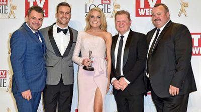 The cast of the NRL Footy Show with their Silver Logie for Most Popular Sports Program. (AAP)